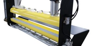 Roller coating machine used with metal stamping presses